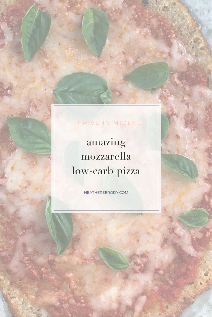 amazing mozzarella low carb pizza: just 2 carbs per 1/2 pizza! So easy to make. now you can feel good about Friday night pizza night. #keto